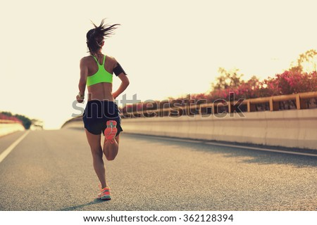young woman runner running on city bridge road #362128394
