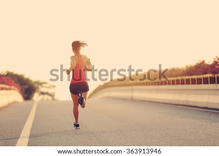 young woman runner running on city bridge road #363913946