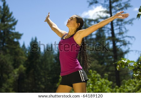 Young woman runner working out in a park - stock photo