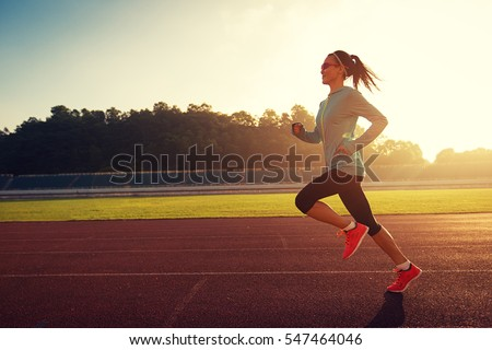 young woman running during...