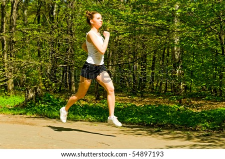 young woman running in park