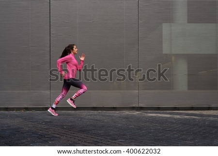young woman running on the...