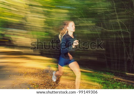 Young Woman Running on Trail with Motion Blur
