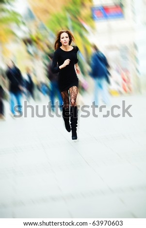 young woman running through the city