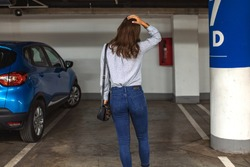 Young woman's car was stolen, can't find car at underground parking. Woman returned after shopping and didn't find her car on underground parking.