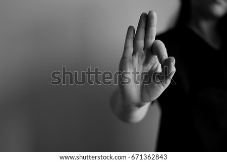 Young woman's hand shows ok. Gesture #671362843