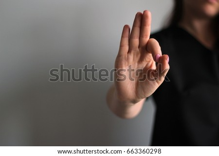 Young woman's hands shows ok. Gesture #663360298