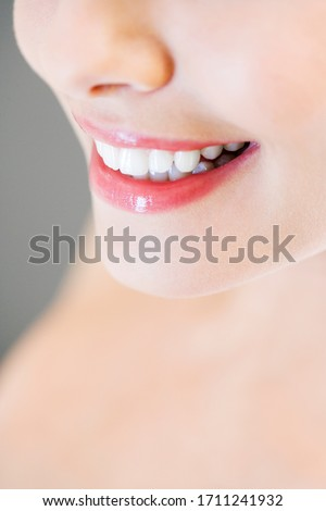Young woman's smile and nose close up