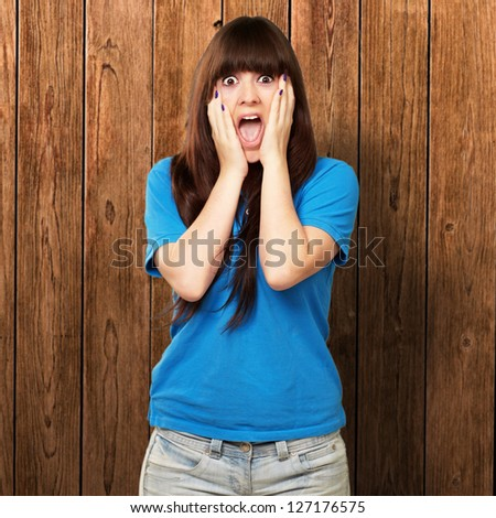 young woman screaming on wall
