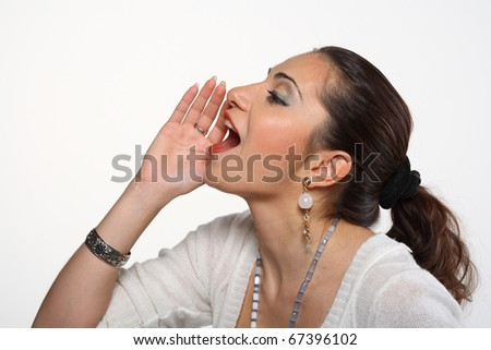 young woman screaming on white background with copy space for your text
