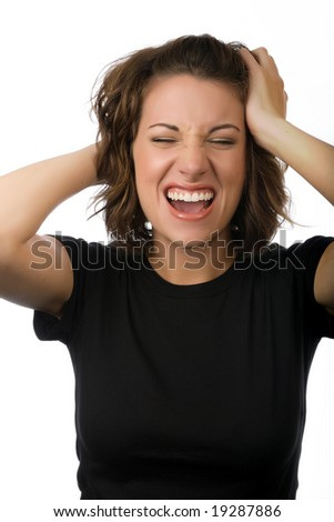Young woman screaming while holding her head