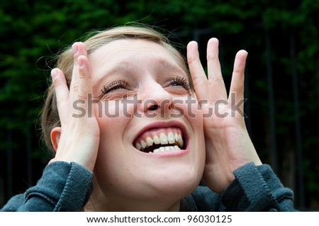 Young woman screaming with crazy expression - stock photo
