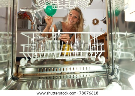 young woman seen from inside of a dish washer