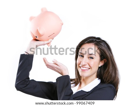 Young woman shaking her piggy bank