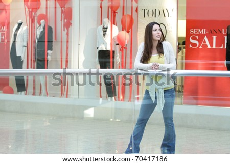 Young woman shopping at the mall for sales