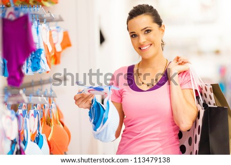 7a53febe4 Happy women looking at a bra in shopping mall Images and Stock ...
