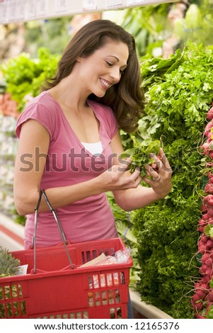 Young woman shopping for produce in supermarket