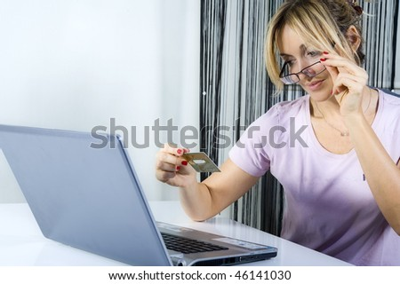 young woman shopping online with credit card and laptop computer