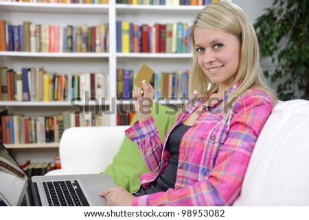 young woman shopping online with laptop