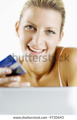 young woman shopping through her laptop with credit card