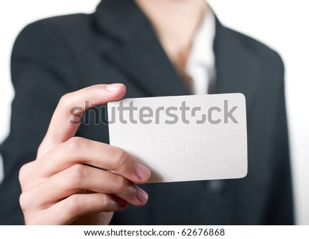 young woman showing her business card closeup