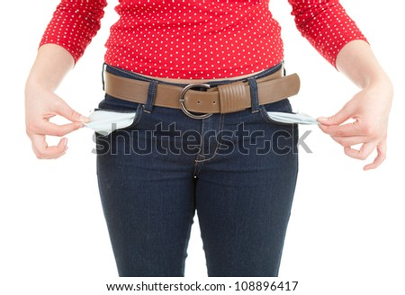 young woman showing she has no money by turning out her pockets, white background