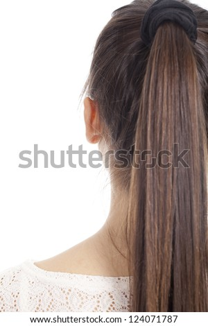 Young woman shows her long hair back
