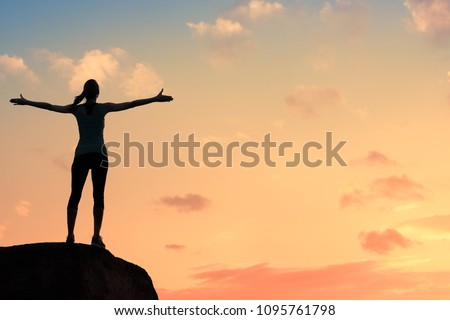 young woman silhouette against...