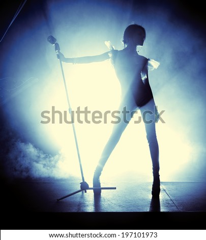 Young woman singer. Contrast silhouette.