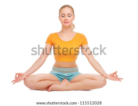 Young woman sits in a lotus pose