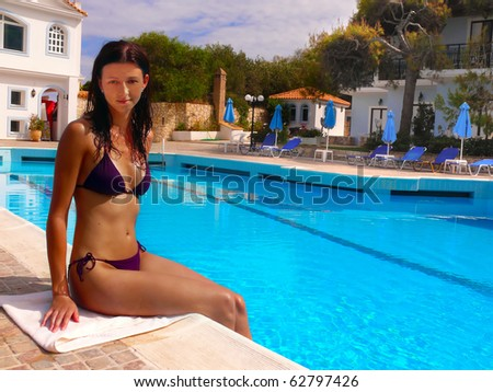 Young woman sitting at a pool