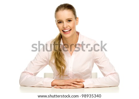 Young woman sitting at white table