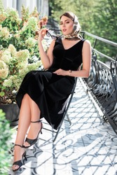 Young woman sitting  in balcony.Sensual lady. Female fashion.Beautiful girl breathing fresh air on villa balcony in morning.