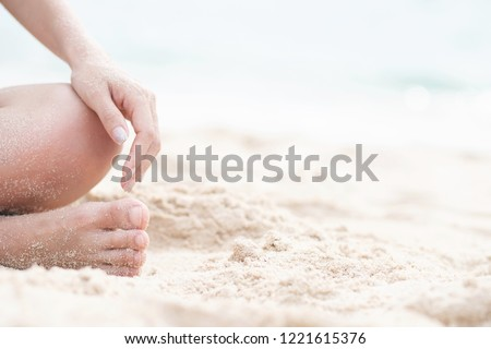 young woman sitting in relaxation outdoors on tropical beach with sand, body parts. Tanned sunbath girl in Lotus position yoga relax, and meditation. summer travel holiday concept. #1221615376