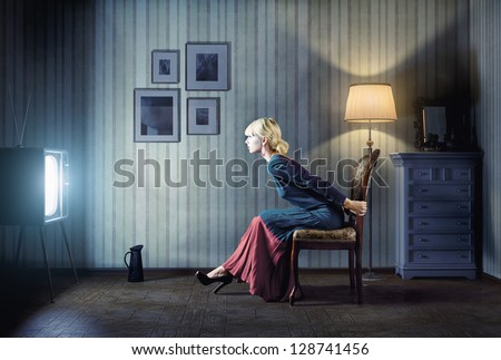 young  woman sitting on a chair ...