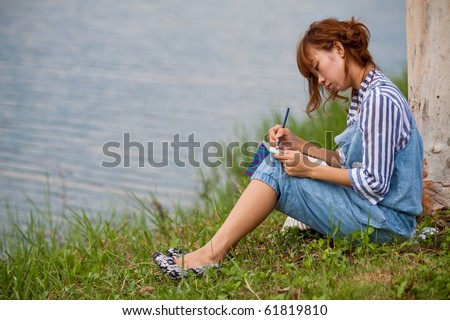 Young woman sitting on a park.