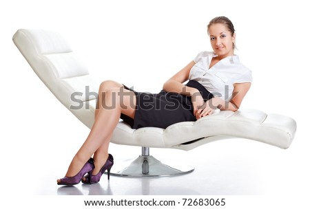 young woman sitting on couch, isolated on white