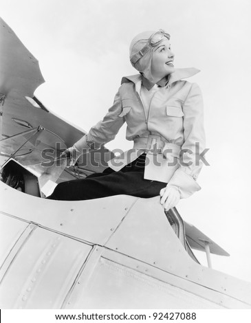 young woman sitting on top of a ...