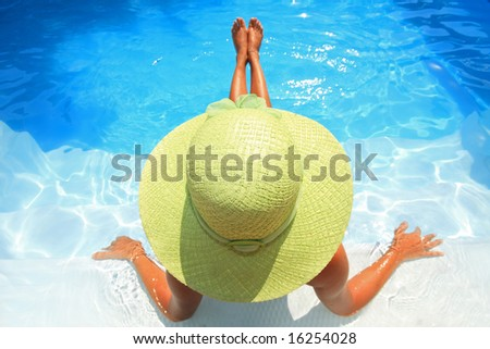 Young woman sittingin a swimming pool