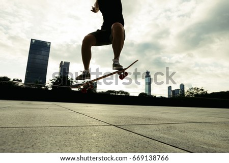 young woman skateboarder skateboarding at city #669138766