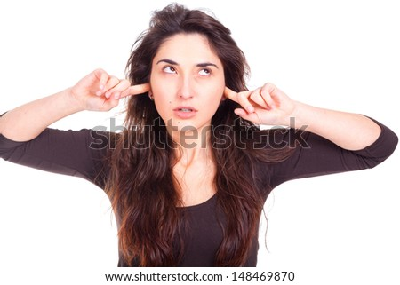 young woman slapping ears or fingers, silence ...