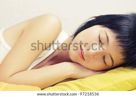 Young woman sleeping in bed, tranquil scene