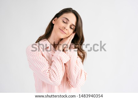 Young woman sleeping in standing position