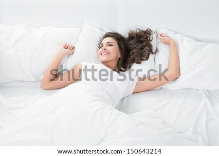 young woman sleeping on the white linen in bed at home, top view #150643214