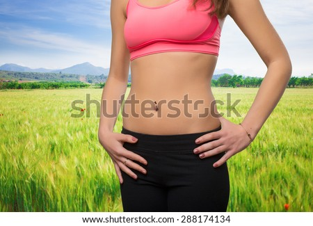 Young woman slim belly closeup