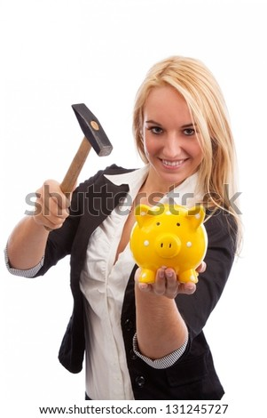 Young woman smashing piggy bank isolated on white