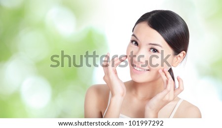 Young woman smile and hand touch face concept for health body care with green nature background, model is a asian beauty - stock photo