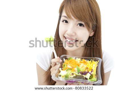young Woman smiling and holding  vegetable and salad
