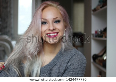 Young Woman Smiling And Posing. A Portrait Of A Smiling Young Woman. Young Woman In Apartment.
