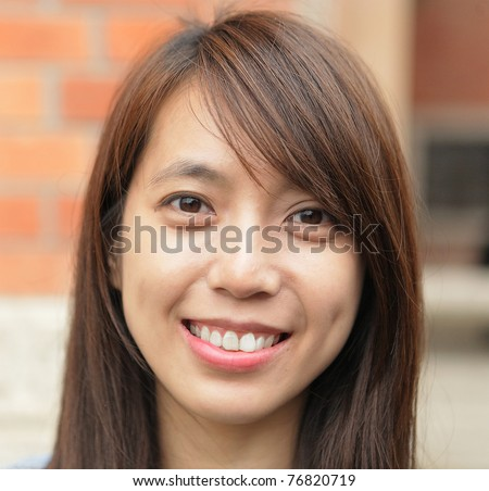 young woman smiling friendly